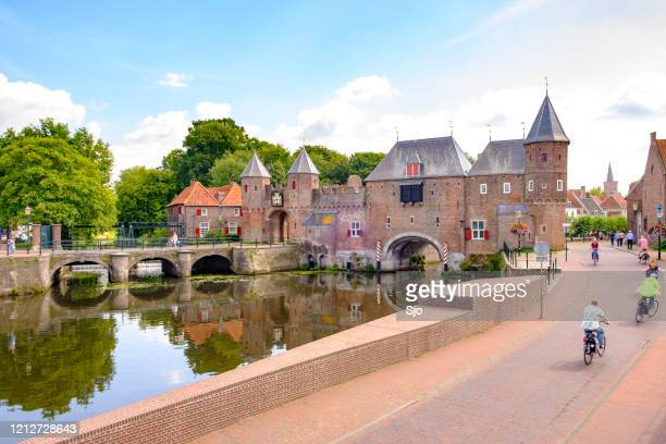 "medieval koppelpoort town wall and gate over the eem river in amersfoort - ""sjoerd van der wal"" or ""sjo"" stock pictures, royalty-free photos & images"