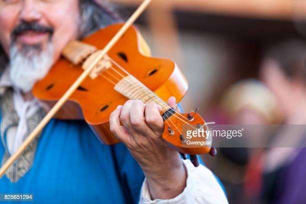 Medieval minstrel playing violin