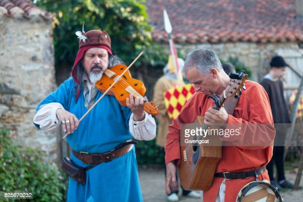 Medieval minstrels playing music