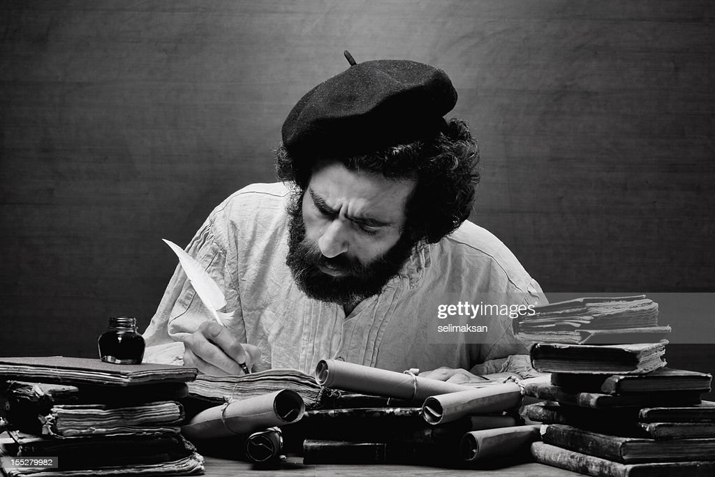 Medieval philosopher in search for inspiration on his desk : Stock Photo