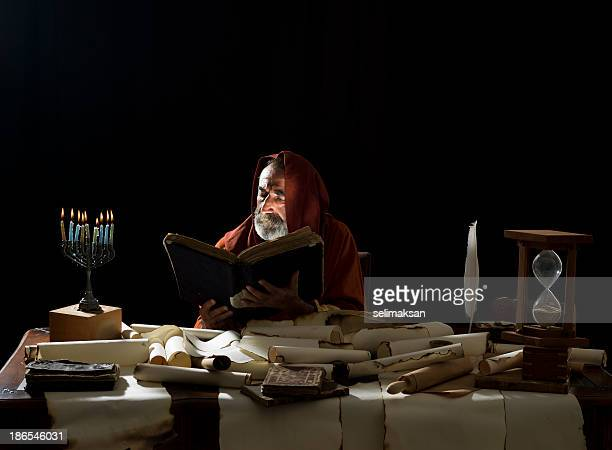medieval philosopher reading torah in the light of menorah - torah stock photos and pictures