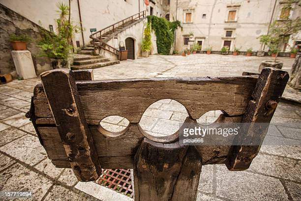 medieval pillory in a village square - corporal punishment stock pictures, royalty-free photos & images