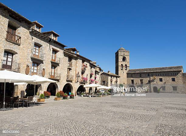 medieval plaza of the people of ainsa with his town hall to the bottom and his church,  pyrenees, huesca spain - town stock pictures, royalty-free photos & images