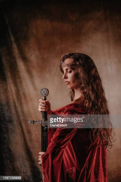 medieval princess holding a sword in her hands - satin dress stock pictures, royalty-free photos & images