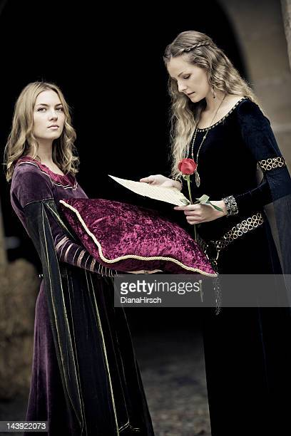 medieval queen with court lady and letter