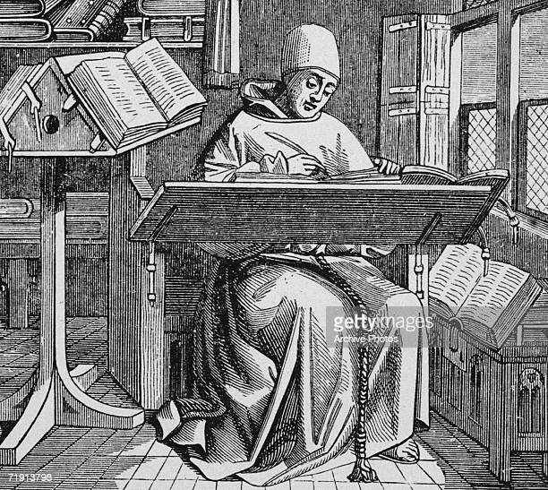 A medieval scribe writes at his desk surrounded by open manuscripts 15th Century