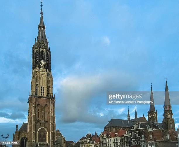 medieval skyline of delft under dramatic sky - nieuwe kerk delft stock photos and pictures