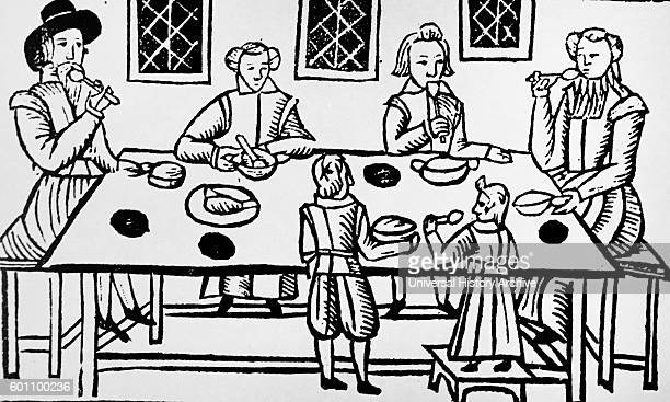 Medieval Spanish nobles eat at a feast attended to by servants Circa 9th century