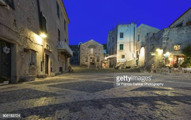 medieval square in borgio verezzi illuminated at dusk in liguria, italian riviera, italy - taormina stock pictures, royalty-free photos & images