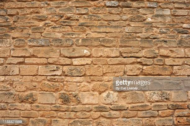 medieval stone wall background - stone wall stock pictures, royalty-free photos & images