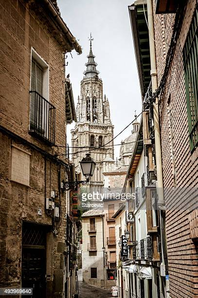 Medieval street in Toledo, Spain with cathedral and stores