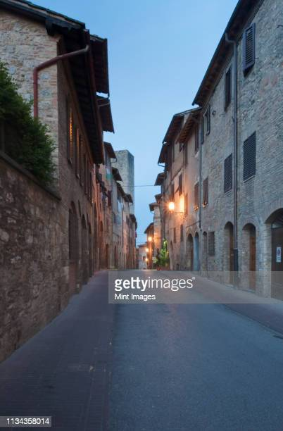 medieval street - stone house stock pictures, royalty-free photos & images