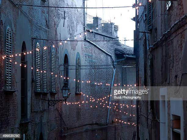 Medieval streets with christmas strings of lights  in a small town in Italy