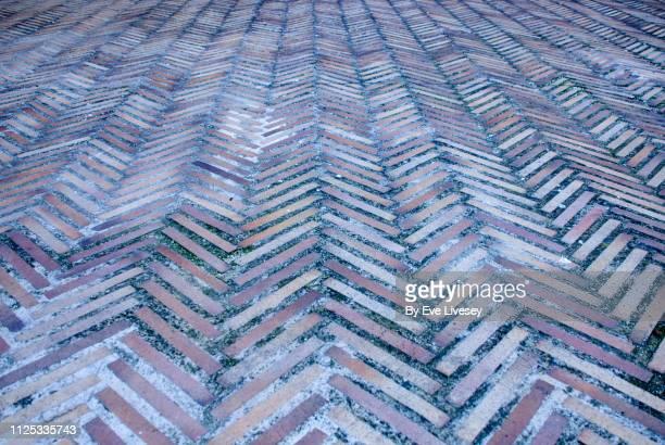 medieval tiled floor - herringbone floor stock photos and pictures