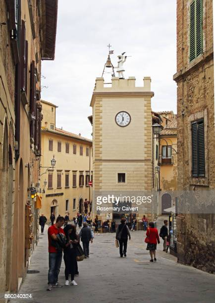 medieval tower house with bell struck by figure and clock. - clock tower stock pictures, royalty-free photos & images