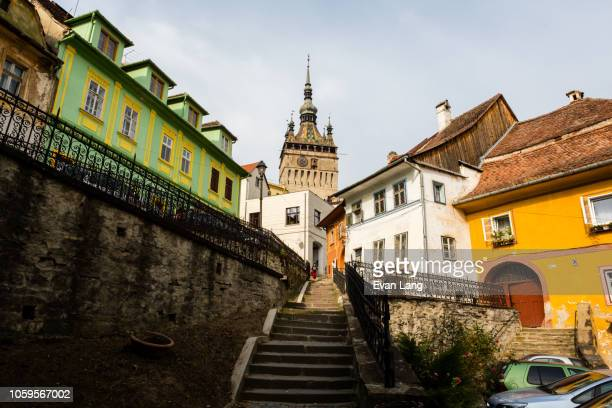 medieval tower, staircase, and colorful european streets - romania stock pictures, royalty-free photos & images