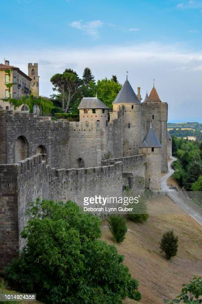 medieval walls in carcassonne, france - carcassonne stock pictures, royalty-free photos & images