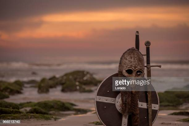 Medieval warrior equipment on a cold seashore at dusk