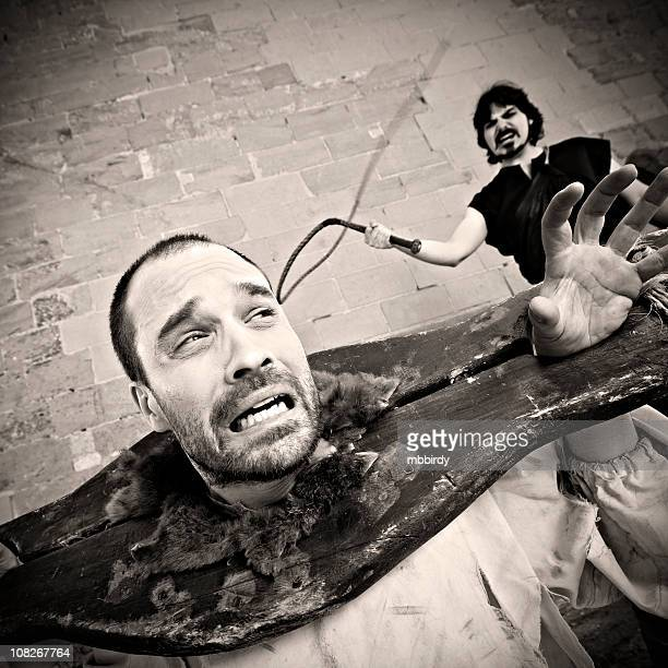 medieval whipping torture - punishment of slaves stock photos and pictures