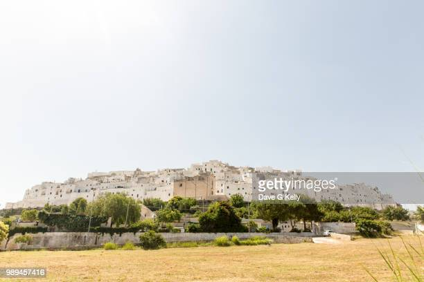 medieval whitewashed hilltop puglian town - ostuni stock photos and pictures