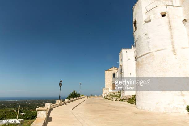 medieval whitewashed hilltop town - ostuni stock photos and pictures