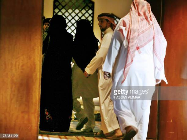 The mother of the critically wounded 22yearsold French man wears the traditional Saudi 'abaya' and a headscarf as she visits her son at a hospital in...
