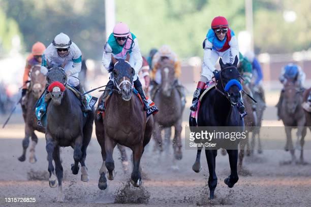 Medina Spirit, ridden by jockey John Velazquez, crosses the finish line to win the 147th running of the Kentucky Derby at Churchill Downs on May 01,...