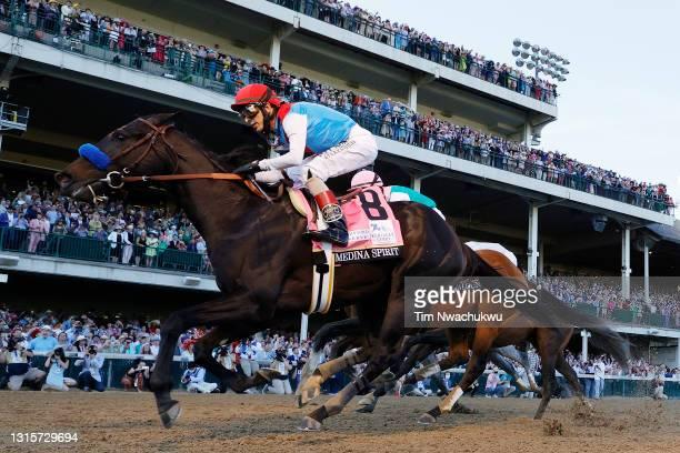 Medina Spirit, ridden by jockey John Velazquez, crosses the finish line to win the 147th running of the Kentucky Derby ahead of Mandaloun, ridden by...