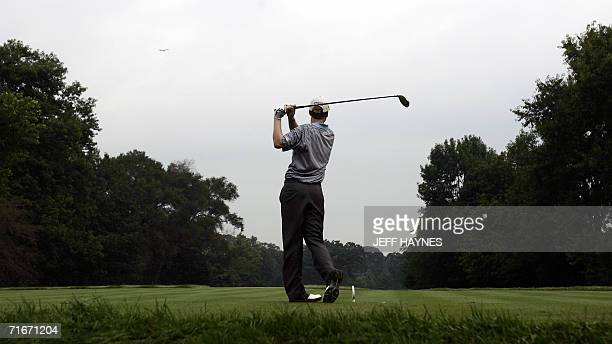 First round coleader Chris Riley of the US hits his tee shot on the seventh hole 18 August 2006 during the second round of the 88th PGA golf...