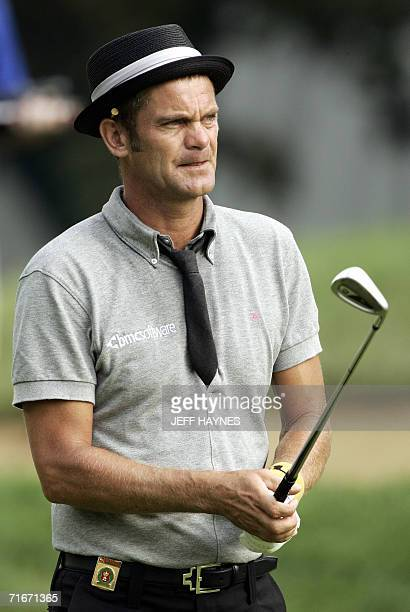 Golfer Jesper Parnevik of Sweden hits his approach shot on the first hole 18 August 2006 during the second round of the 88th PGA golf championship at...
