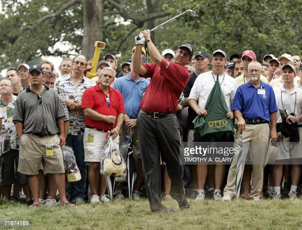Golfer Phil Mickelson of the US hits out of the rough on the third hole 18 August 2006 during the second round of the 88th PGA golf championship at...