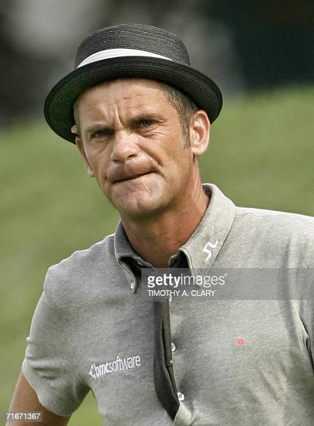 Jesper Parnevik of Sweden waits to hit out of the rough on the 1st hole during the 2nd round of the 2006 PGA Championship at Medinah Country Club on...