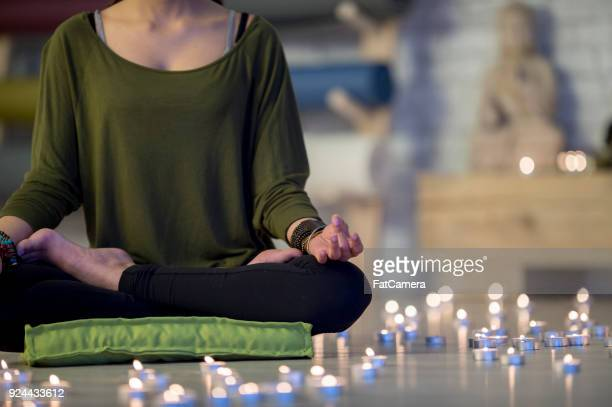meditating among candles - cushion stock pictures, royalty-free photos & images