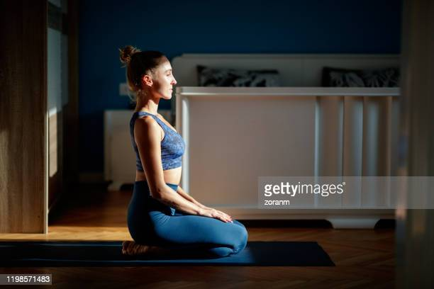 meditating at home - mindfulness stock pictures, royalty-free photos & images