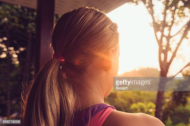 Meditating European Woman Viewing Sunrise From Yoga Shala in Thailand