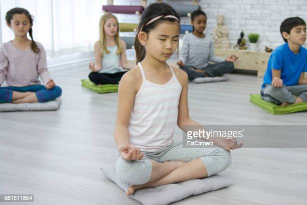 Meditating in Kids Yoga Class