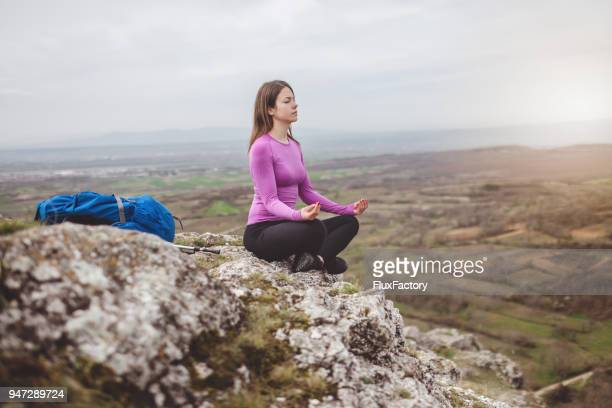 meditating on the top - purple boot stock photos and pictures
