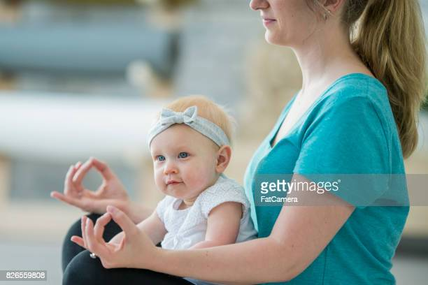 Meditating With Her Baby