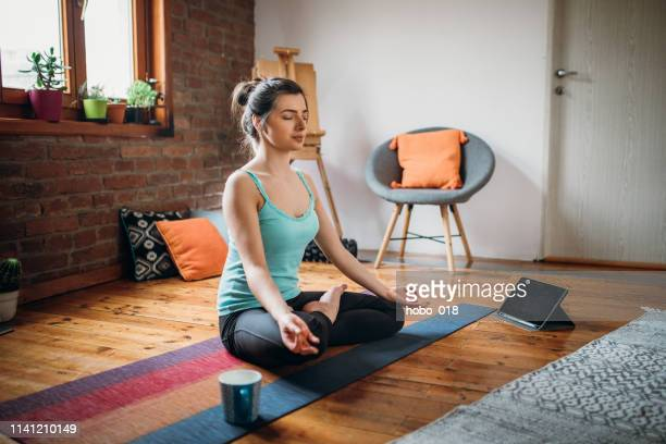 meditation and spirituality at home - buddhism stock pictures, royalty-free photos & images