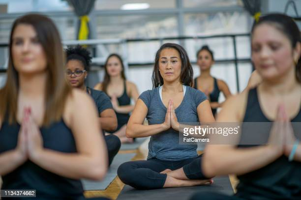 meditation class - 18 19 years stock pictures, royalty-free photos & images