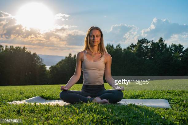 meditation in nature at sunset. - lotus position stock pictures, royalty-free photos & images
