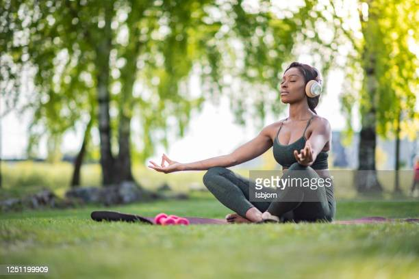 meditation in nature. - natural parkland stock pictures, royalty-free photos & images