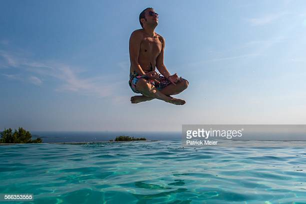 Meditation in the air above infinity pool in South of France