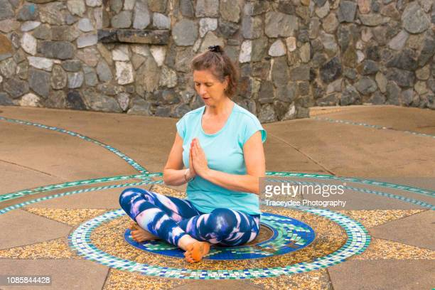 Meditation in Yoga by a woman aged 50 years and older