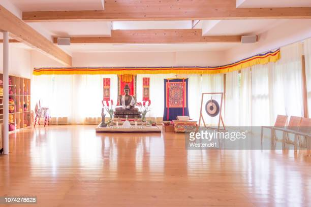 meditation room in a buddhist meditation center - yoga studio stock pictures, royalty-free photos & images