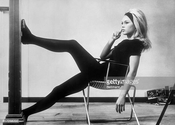 "Meditative mood holds French ""sex kitten"" Brigitte Bardot as she relaxes on the set of the French film A Very Private Affair. The movie is a..."
