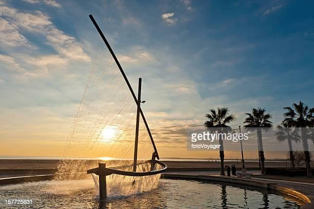 Mediterranean beach fountain sunrise Valencia Spain