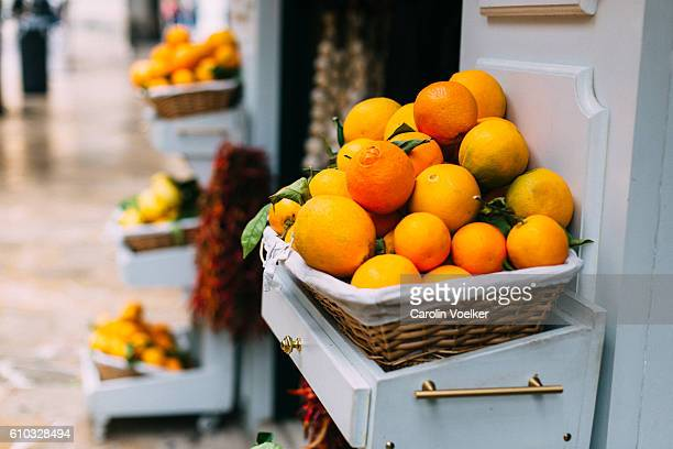 Mediterranean fruit baskets with oranges in front of a fruit store in Palma de Mallorca