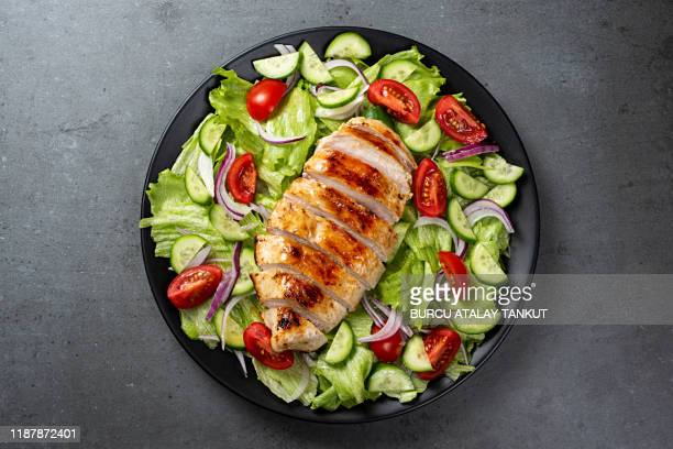 mediterranean grilled chicken salad - chicken meat stock pictures, royalty-free photos & images