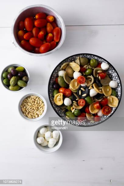 mediterranean orecchiette with tomato, olives, mozzarella - mediterranean food stock pictures, royalty-free photos & images